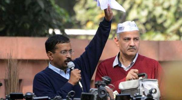 Delhi Chief Minister Arvind Kejriwal with Education Minister Manish Sisodia during the protest near Rail Bhawan in New Delhi on Monday. Photo courtesy The HIndu