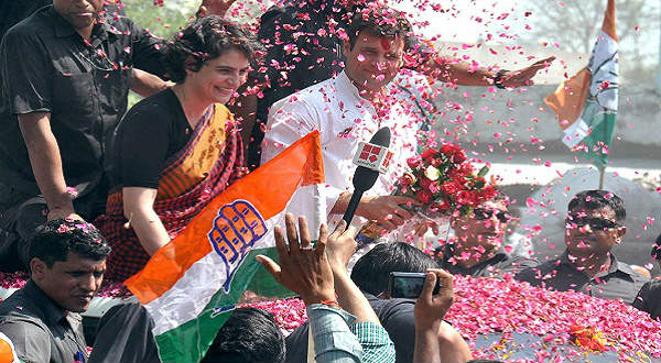 Supporters showers rose petals as Congress vice president Rahul Gandhi along with his sister Priyanka Vadra is on his way to file nomination papers for Lok Sabha in Amethi on April 12, 2014. IANS