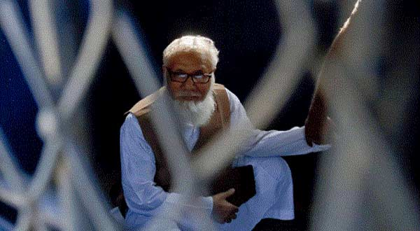 Bangladesh Jamaat-e-Islami chief Motiur Rahman Nizami sits inside a van as he is taken to a prison after being sentenced at the International Crimes Tribunal court in Dhaka on October 29, 2014. AFP photo