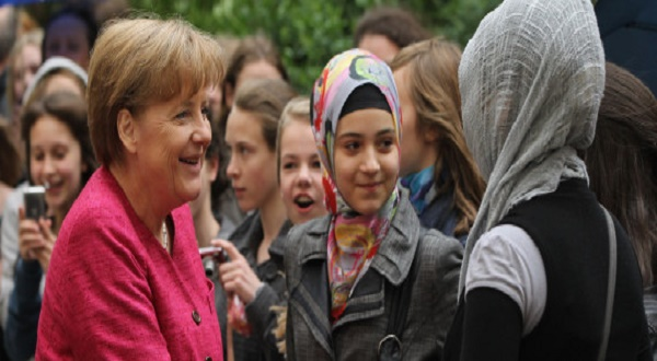 BERLIN, GERMANY - MAY 16:  German Chancellor Angela Merkel greets students at the Sophie Scholl school during a visit on the fifth European Union school project day on May 16, 2011 in Berlin, Germany. The nationwide initiative is meant to foster a stronger understanding young people of the role of the European Union.  (Photo by Sean Gallup/Getty Images)