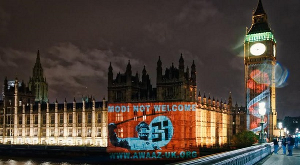 Projection of Narendra Modi holding a sword in one hand and a shield with the Oum symbol with a swastika superimposed appeared on the Houses of Parliament next to the iconic Big Ben