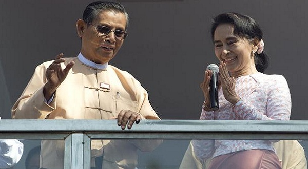 Leader of Myanmar's National League for Democracy party, Aung San Suu Kyi, delivers a speech with party patron Tin Oo from a balcony of her party's headquarters in Yangon, Myanmar on Monday. (AP)